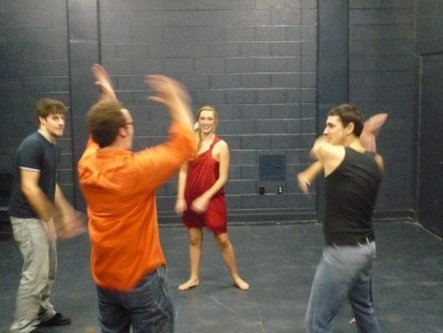 Group exercise before a performance in college